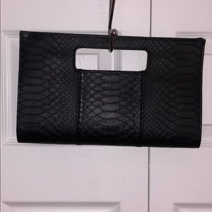Faux snakeskin black clutch